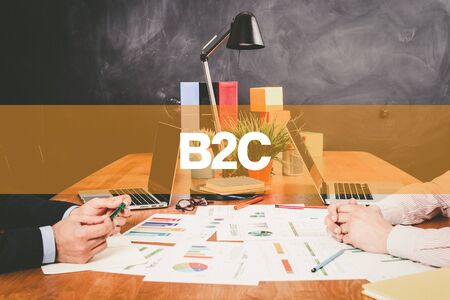 b2c: Two Businessman B2C working in an office Stock Photo