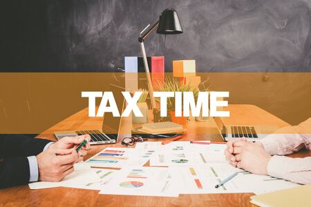 exemption: Two Businessman Tax Time working in an office
