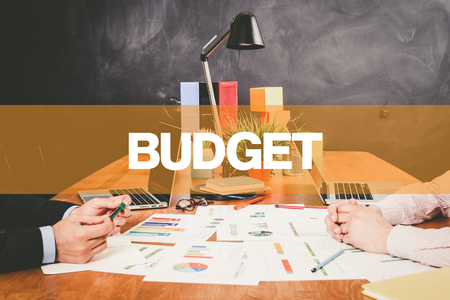 deficit target: Two Businessman Budget working in an office Stock Photo