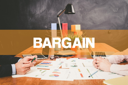 bargain: Two Businessman Bargain working in an office