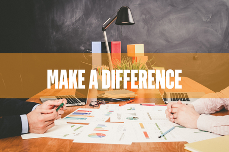 difference: Two Businessman  Make A Difference working in an office