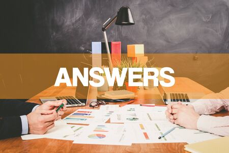 warranty questions: Two Businessman Answers working in an office