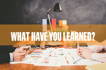 learned: Two Businessman  What Have You Learned? working in an office