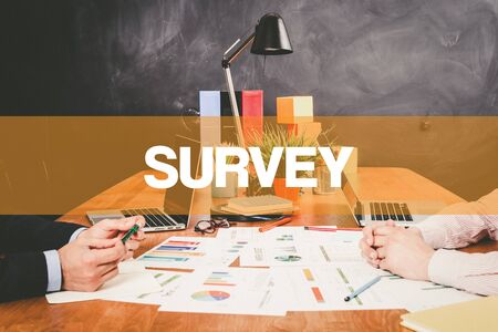 poll: Two Businessman Survey working in an office