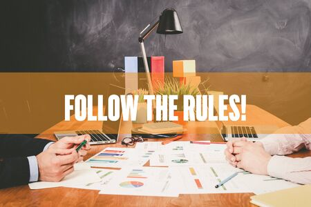 governing: Two Businessman  Follow The Rules! working in an office