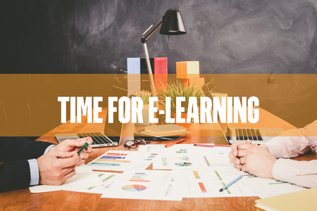 instances: Two Businessman  Time For E-Learning working in an office