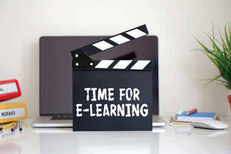 instances: Cinema Clapper with Time For E-Learning word Stock Photo