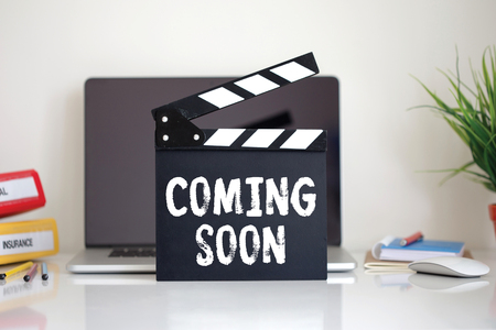 presently: Cinema Clapper with Coming Soon word