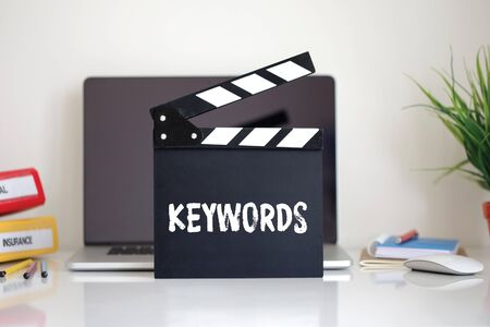 keywords: Cinema Clapper with Keywords word Stock Photo