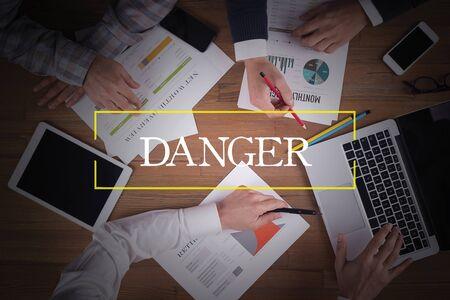 hazardous area sign: BUSINESS TEAM WORKING OFFICE  Danger TEAMWORK BRAINSTORMING EDUCATION CONCEPT