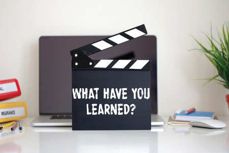 learned: Cinema Clapper with What Have You Learned? word Stock Photo