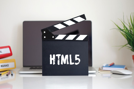 html5: Cinema Clapper with Html5 word Stock Photo
