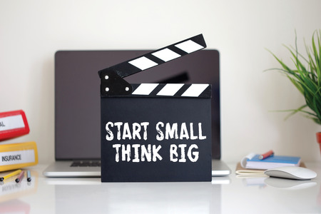surpass: Cinema Clapper with Start Small Think Big word