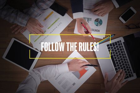 governing: BUSINESS TEAM WORKING OFFICE  Follow The Rules! TEAMWORK BRAINSTORMING CONCEPT Stock Photo