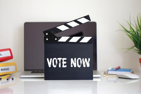 political system: Cinema Clapper with Vote Now word