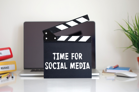 Cinema Clapper with Time For Social Media word Stock Photo