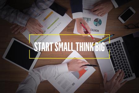 surpass: BUSINESS TEAM WORKING OFFICE  Start Small Think Big TEAMWORK BRAINSTORMING CONCEPT