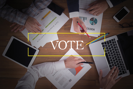 successful campaign: BUSINESS TEAM WORKING OFFICE  Vote TEAMWORK BRAINSTORMING EDUCATION CONCEPT Stock Photo