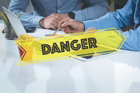 hazardous area sign: BUSINESS WORKING OFFICE Danger TEAMWORK BRAINSTORMING CONCEPT Stock Photo