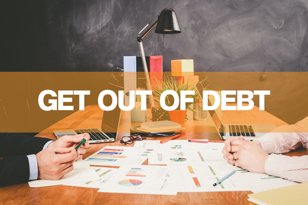 trouble free: Two Businessman Get Out Of Debt working in an office Stock Photo