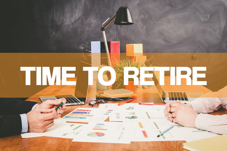 retire: Two Businessman Time To Retire working in an office