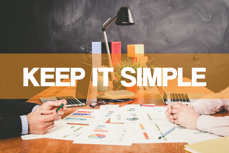 cogent: Two Businessman Keep it Simple working in an office