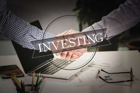 investing: BUSINESS AGREEMENT PARTNERSHIP Investing COMMUNICATION CONCEPT Stock Photo