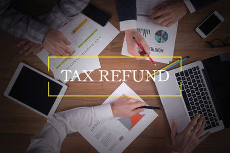 tax refund: BUSINESS TEAM WORKING OFFICE  Tax Refund TEAMWORK BRAINSTORMING CONCEPT