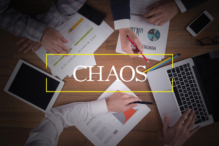 chaos: BUSINESS TEAM WORKING OFFICE  Chaos TEAMWORK BRAINSTORMING CONCEPT Stock Photo