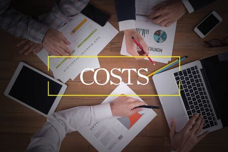 optimizing: BUSINESS TEAM WORKING OFFICE  Costs TEAMWORK BRAINSTORMING CONCEPT Stock Photo