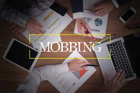 mobbing: BUSINESS TEAM WORKING OFFICE  Mobbing TEAMWORK BRAINSTORMING CONCEPT Stock Photo