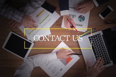 contactus: BUSINESS TEAM WORKING OFFICE  Contact Us TEAMWORK BRAINSTORMING CONCEPT Stock Photo