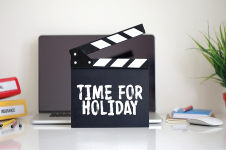 furlough: Cinema Clapper with Time For Holiday word