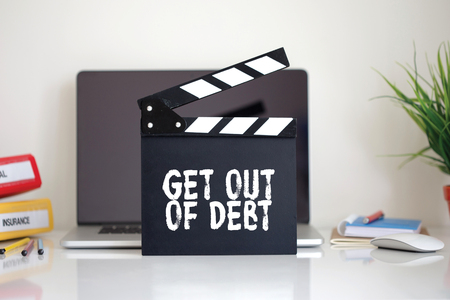 trouble free: Cinema Clapper with Get Out Of Debt word