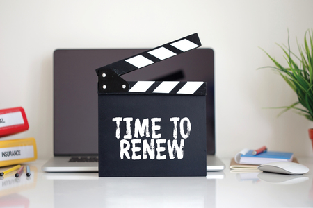 resubscribe: Cinema Clapper with Time To Renew word Stock Photo