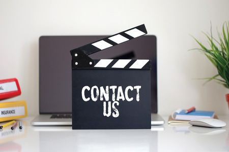 criticize: Cinema Clapper with Contact Us word Stock Photo