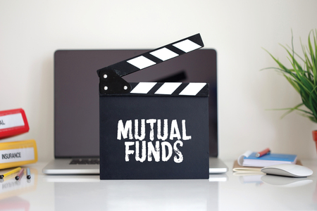 financial diversification: Cinema Clapper with Mutual Funds word