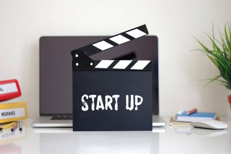 businessteamwork: Cinema Clapper with Start Up word Stock Photo