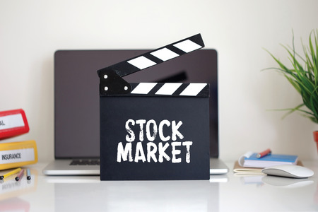stock quotations: Cinema Clapper with Stock Market word Stock Photo