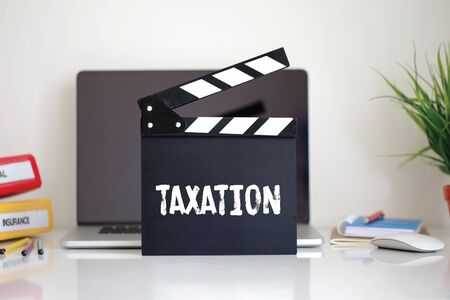 exemption: Cinema Clapper with Taxation word