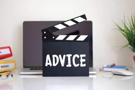 advice: Cinema Clapper with Advice word Stock Photo