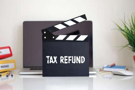 tax refund: Cinema Clapper with Tax Refund word