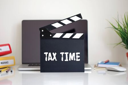 exemption: Cinema Clapper with Tax Time word