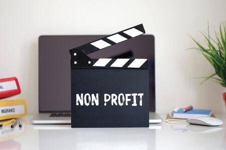 non profit: Cinema Clapper with Non Profit word