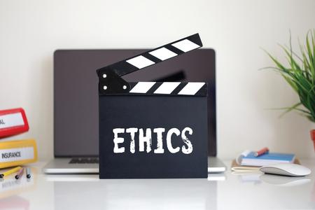 work ethic responsibilities: Cinema Clapper with Ethics word Stock Photo