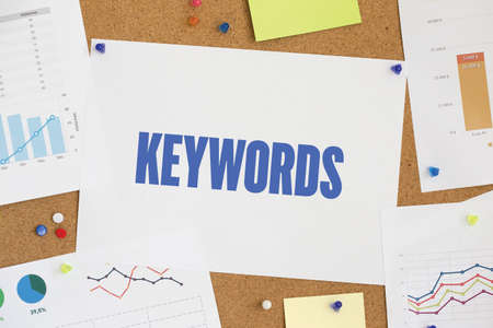 techiques: Charts and Graphs Showing the Results with KEYWORDS word written paper on corkboard