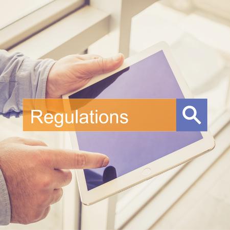 gobierno corporativo: SEARCH TECHNOLOGY COMMUNICATION  Regulations TABLET FINDING CONCEPT Foto de archivo