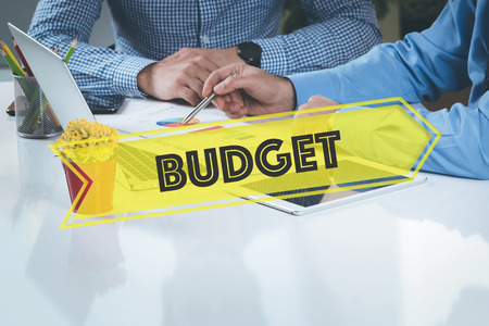 deficit target: BUSINESS WORKING OFFICE Budget TEAMWORK BRAINSTORMING CONCEPT Stock Photo