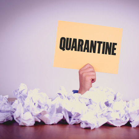 scourge: HAND HOLDING YELLOW PAPER WITH QUARANTINECONCEPT Stock Photo