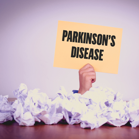 midbrain: HAND HOLDING YELLOW PAPER WITH PARKINSONS DISEASECONCEPT